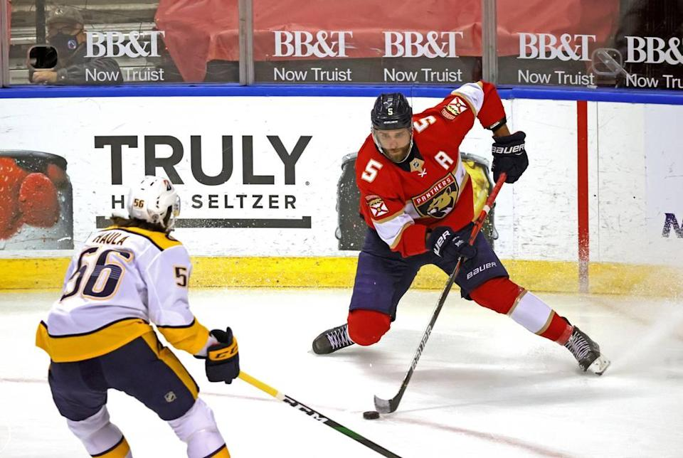 Florida Panthers defenseman Aaron Ekblad (5) carries the puck against Nashville Predators left wing Erik Haula (56) during the first period of their NHL game at the BB&T Center on Thursday, March 18, 2021 in Sunrise, Fl.