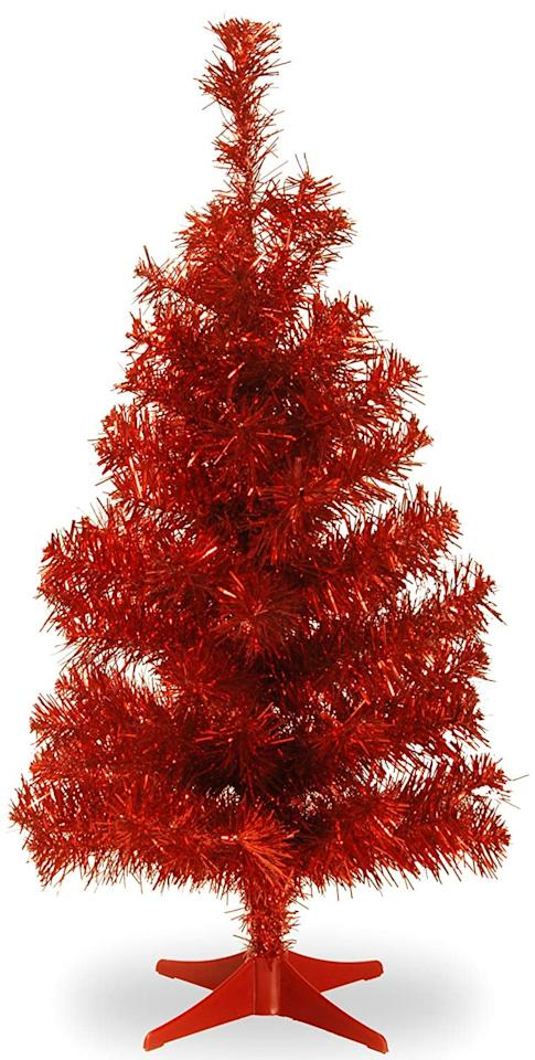 "<p>Place the <a href=""https://www.popsugar.com/buy/National-Tree-2-Foot-Red-Tinsel-Tree-Plastic-Stand-365927?p_name=National%20Tree%202%20Foot%20Red%20Tinsel%20Tree%20With%20Plastic%20Stand&retailer=amazon.com&pid=365927&price=60&evar1=moms%3Aus&evar9=45287444&evar98=https%3A%2F%2Fwww.popsugar.com%2Ffamily%2Fphoto-gallery%2F45287444%2Fimage%2F45287538%2FNational-Tree-2-Foot-Red-Tinsel-Tree-Plastic-Stand&list1=amazon%2Choliday%2Cchristmas%2Cchristmas%20trees&prop13=api&pdata=1"" rel=""nofollow"" data-shoppable-link=""1"" target=""_blank"" class=""ga-track"" data-ga-category=""Related"" data-ga-label=""https://www.amazon.com/National-Tree-Tinsel-Plastic-TT33-704-20-1/dp/B01LYBHOA4/ref=zg_bs_13679421_3?_encoding=UTF8&amp;refRID=YDN85SNHZ2BRM7XHY9VQ"" data-ga-action=""In-Line Links"">National Tree 2 Foot Red Tinsel Tree With Plastic Stand</a> ($60) on a mantel or table or even put it up in the office. It's so festive. If you'd prefer a full-size one, Amazon has them up to six feet tall.</p>"