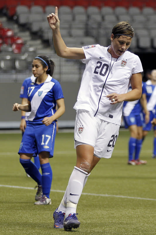 Abby Wambach #20 of the United States celebrates her second goal against Guatemala during the 2012 CONCACAF Women's Olympic Qualifying Tournament at BC Place on Jan. 22, 2012 in Vancouver, British Columbia, Canada. (Photo by Jeff Vinnick/Getty Images)