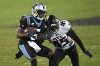 Carolina Panthers quarterback Teddy Bridgewater runs around Atlanta Falcons linebacker Deion Jones during the second half of an NFL football game Thursday, Oct. 29, 2020, in Charlotte, N.C. (AP Photo/Mike McCarn)