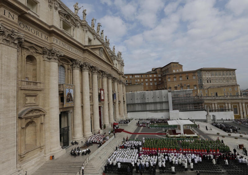Bishops and cardinals attend a Mass celebrated by Pope Benedict XVI for the opening of the synod of bishops in St. Peter square at the Vatican, Sunday, Oct. 7 , 2012. (AP Photo/Alessandra Tarantino)