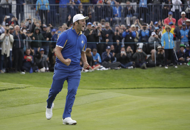 FILE - In this Sept. 30, 2018, file photo, Europe's Jon Rahm celebrates after beating Tiger Woods in a singles match on the final day of the 42nd Ryder Cup at Le Golf National in Saint-Quentin-en-Yvelines, outside Paris, France. Rahm says it was the best moment of his golf career.(AP Photo/Matt Dunham, File)