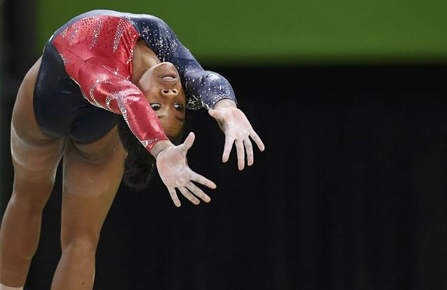 2016 Rio Olympics - Artistic Gymnastics - Preliminary - Women's Qualification - Subdivisions - Rio Olympic Arena - Rio de Janeiro, Brazil - 07/08/2016. Gabrielle Douglas (USA) of USA (Gabby Douglas) competes on the beam during the women's qualifications. REUTERS/Dylan Martinez FOR EDITORIAL USE ONLY. NOT FOR SALE FOR MARKETING OR ADVERTISING CAMPAIGNS.