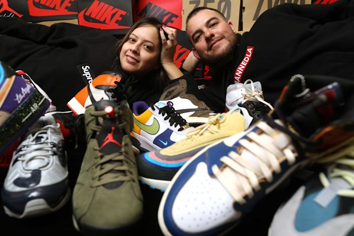 """Vivian Velasquez, and her husband, Manny Cruz, with their sneaker collection in Paramount. <span class=""""copyright"""">(Gary Coronado/Los Angeles Times)</span>"""