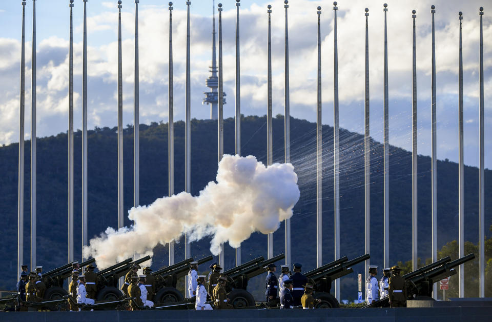 The Australian Federation Guard fire a 41 gun salute to mark the passing of Prince Philip on the forecourt of Parliament House, in Canberra, Australia, Saturday, April 10, 2021. Prince Philip, the irascible and tough-minded husband of Queen Elizabeth II who spent more than seven decades supporting his wife in a role that mostly defined his life, has died, Buckingham Palace said Friday, April 9. He was 99. (Lukas Coch/AAP Image via AP)