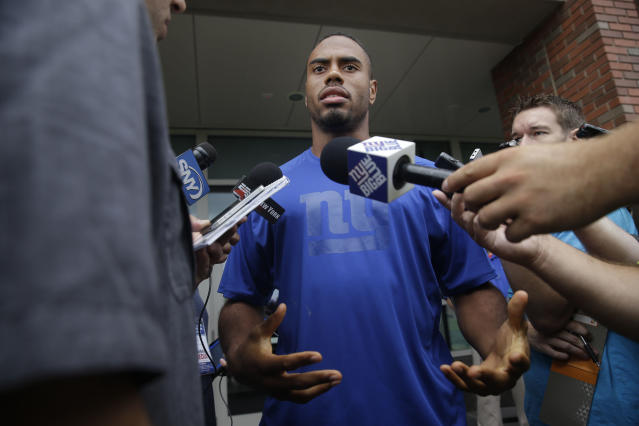 New York Giants' Rashad Jennings talks to reporters during a NFL football camp in East Rutherford, N.J., Thursday, July 24, 2014. (AP Photo/Seth Wenig)