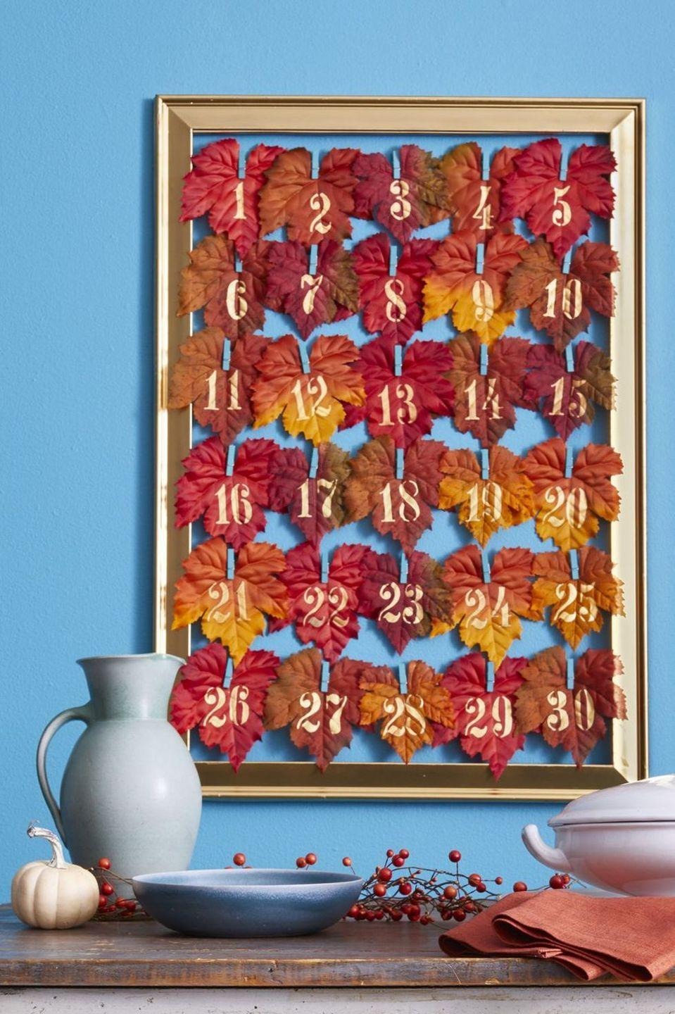 "<p>Long before Christmas, there's another excuse to whip out an ""advent calendar."" Clothespins, faux leaves, and notes of gratitude (penned by your kids!) make it easy. </p><p><strong>To Make: </strong>Outfit an empty frame with horizontal lengths of twine or ribbon and clip on numbered leaves (we used a gold paint marker and stencils). Each day of November, write something you're grateful for on a paper tag and put it behind the leaf that displays that date.</p><p><a class=""link rapid-noclick-resp"" href=""https://www.amazon.com/HZOnline-Artificial-Scrapbooking-Photography-Decorations/dp/B07FMH6W59?tag=syn-yahoo-20&ascsubtag=%5Bartid%7C10050.g.22626432%5Bsrc%7Cyahoo-us"" rel=""nofollow noopener"" target=""_blank"" data-ylk=""slk:SHOP FAUX LEAVES"">SHOP FAUX LEAVES</a></p>"
