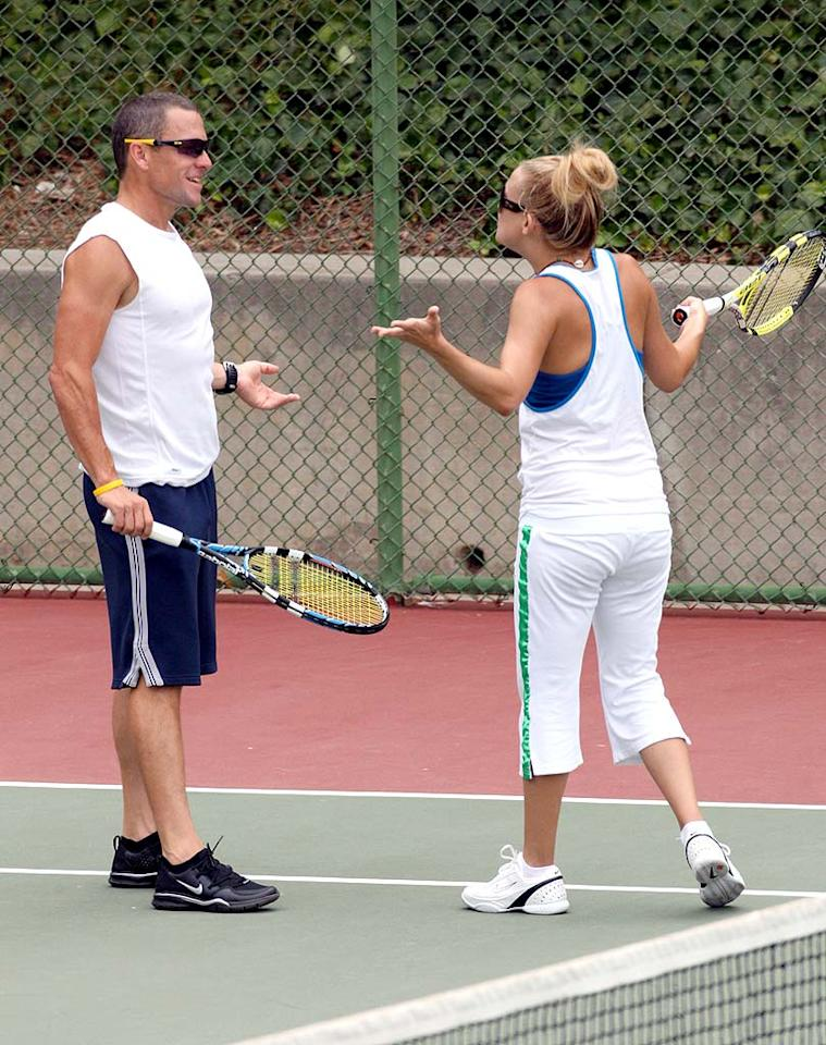 """The couple argues over a missed shot. Ginsburg-Spaly-DiCapua/<a href=""""http://www.x17online.com"""" target=""""new"""">X17 Online</a> - July 8, 2008"""