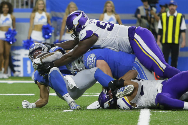 Detroit Lions running back Ty Johnson, left, is stopped by Minnesota Vikings defensive tackle Shamar Stephen during the second half of an NFL football game, Sunday, Oct. 20, 2019, in Detroit. (AP Photo/Duane Burleson)