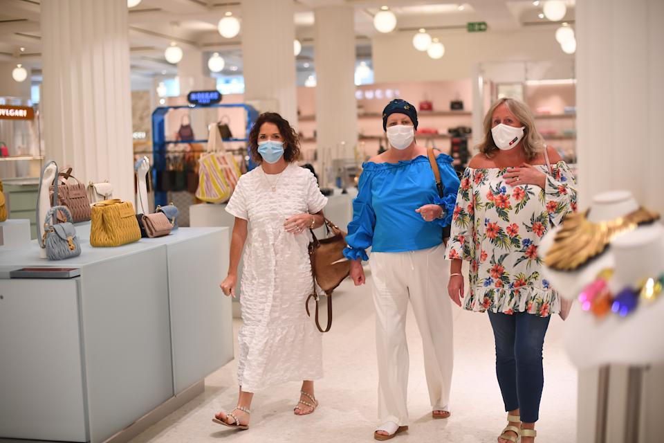 Shoppers wearing a face masks in Selfridges on Oxford Street, London, as face coverings become mandatory in shops and supermarkets in England. (Photo by Victoria Jones/PA Images via Getty Images)