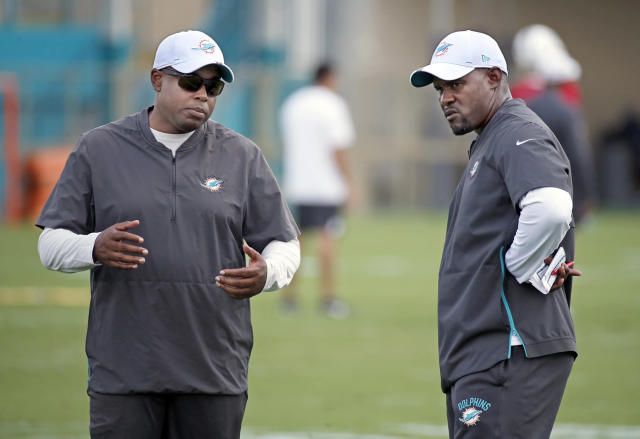 Miami Dolphins general manager Chris Grier, left, and head coach Brian Flores have a chance to rewrite the franchise's course with a big offseason. (Al Diaz/Miami Herald/Tribune News Service via Getty Images)