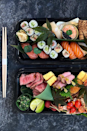 "<p>Chelsea's swanky Japanese spot Dinings SW3 let's you make restaurant quality sushi at home. Using the finest, sustainable fish and seafood, nori sheets and sushi rice, learn how to make your own tuna, salmon, lobster and scallop temaki.</p><p>If you'd rather sit back and relax, chef's Masaki Sugisaki's four-course Valentine's Day box is a seafood feast for two. Think tuna tartare, potted native Lobster and hand dived scallop, along with a mosaic style selection of fish and seafood with Beluga caviar and raspberry infused sushi rice. </p><p>Make Your Own Temaki Handroll <br>Price:£135</p><p>Valentine's Day Feast<br>Price: £140</p><p>Available across London</p><p>Order <a class=""link rapid-noclick-resp"" href=""https://diningssw3.co.uk/dinings-at-home"" rel=""nofollow noopener"" target=""_blank"" data-ylk=""slk:here"">here</a></p>"