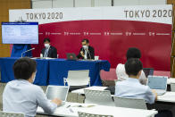 Deputy Executive Director, Marketing & Senior Director of Ticketing of Tokyo 2020 Organizing Committee Suzuki Hidenori, left, and Spokesperson of Tokyo 2020 Organizing Committee Masa Takaya attend a press conference regarding Olympic and Paralympic Games tickets, Friday, July 9, 2021, in Tokyo. Tokyo Olympic organizers stated yesterday that spectators would be barred from most events at the Games after a new state of emergency was announced in response to a surge in coronavirus cases. The state of emergency will run throughout the Olympic Games and remain in place until August 22. (Yuichi Yamazaki/Pool Photo via AP)