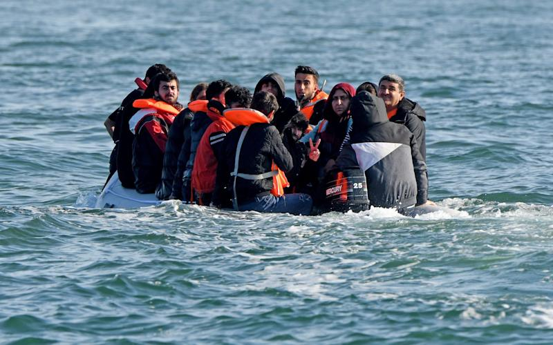 A small boat carrying migrants in the English Channel last month. - Steve Finn/Steve Finn Photography