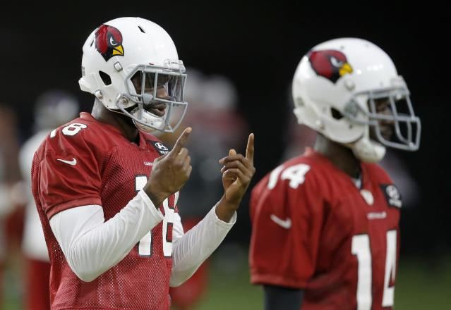 Arizona Cardinals wide receiver Greg Little signals to a coach during NFL football practice Thursday, Aug. 9, 2018, in Glendale, Ariz. (AP Photo/Ross D. Franklin)