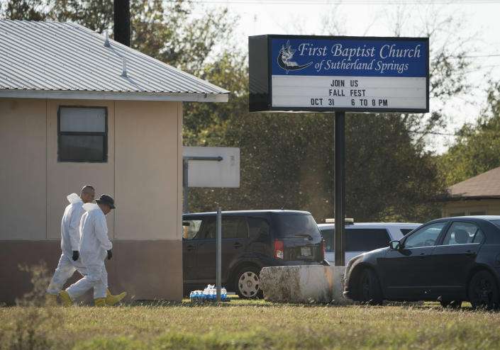 <p>Members of the FBI Hazardous Evidence Response Team walk next to the First Baptist Church of Sutherland Springs in response to a fatal shooting, Nov. 5, 2017, in Sutherland Springs, Texas. (Darren Abate/AP) </p>