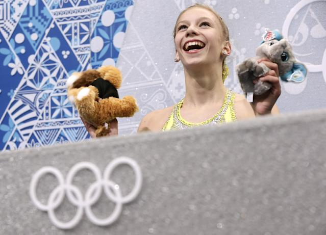 Polina Edmunds of the United States waits in the results area after completing her routine in the women's short program figure skating competition at the Iceberg Skating Palace during the 2014 Winter Olympics, Wednesday, Feb. 19, 2014, in Sochi, Russia. (AP Photo/Bernat Armangue)