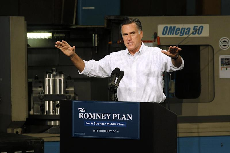 This photo taken Aug. 7, 2012 shows Republican presidential candidate, former Massachusetts Gov. Mitt Romney campaigning in Elk Grove Village, Ill. Barack Obama's backers roll out a new ad assailing Mitt Romney's business record at Bain Capital, while the Republican candidate seeks to paint the Democrat as a big-government liberal.  (AP Photo/Charles Dharapak)