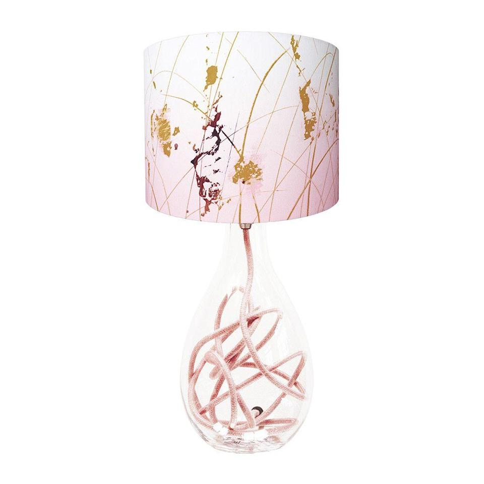 """<p>If you're not comfortable decking out your room in monotone pink, this statement piece is a great baby step.</p><p><strong>Anna Jacobs</strong> Afternoon Dreaming Lamp Shade, $67, available at <a href=""""https://us.amara.com/products/afternoon-dreaming-lamp-shade-small"""" rel=""""nofollow noopener"""" target=""""_blank"""" data-ylk=""""slk:Amara"""" class=""""link rapid-noclick-resp"""">Amara</a></p>"""