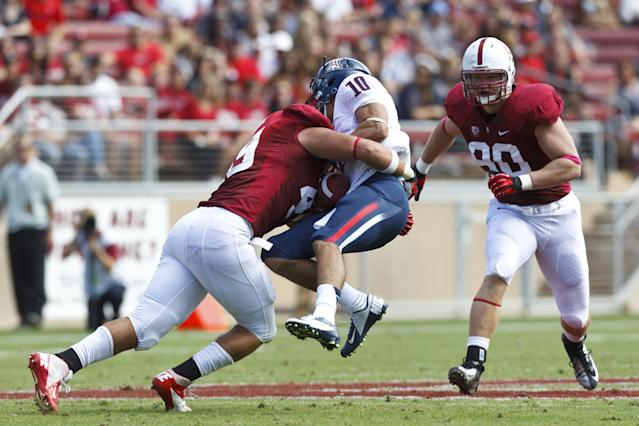 PALO ALTO, CA - OCTOBER 06: Quarterback Matt Scott #10 of the Arizona Wildcats is sacked by defensive end Ben Gardner #49 of the Stanford Cardinal during the second quarter at Stanford Stadium on October 6, 2012 in Palo Alto, California. (Photo by Jason O. Watson/Getty Images)