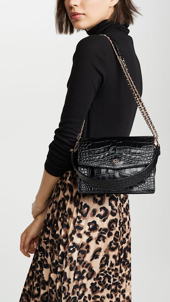 """<p>We love that this pretty <a href=""""https://www.popsugar.com/buy/Tory-Burch-Robinson-Embossed-Shoulder-Bag-552771?p_name=Tory%20Burch%20Robinson%20Embossed%20Shoulder%20Bag&retailer=shopbop.com&pid=552771&price=498&evar1=fab%3Aus&evar9=35939418&evar98=https%3A%2F%2Fwww.popsugar.com%2Ffashion%2Fphoto-gallery%2F35939418%2Fimage%2F47265775%2FTory-Burch-Robinson-Embossed-Shoulder-Bag&list1=shopping%2Caccessories%2Cbags&prop13=mobile&pdata=1"""" rel=""""nofollow"""" data-shoppable-link=""""1"""" target=""""_blank"""" class=""""ga-track"""" data-ga-category=""""Related"""" data-ga-label=""""https://www.shopbop.com/robinson-embossed-shoulder-bag-tory/vp/v=1/1559291988.htm?folderID=13505&amp;fm=other-viewall&amp;os=false&amp;colorId=1071C&amp;ref=SB_PLP_NB_26"""" data-ga-action=""""In-Line Links"""">Tory Burch Robinson Embossed Shoulder Bag</a> ($498) has both a short and long strap, so you can really do what you want with it.</p>"""
