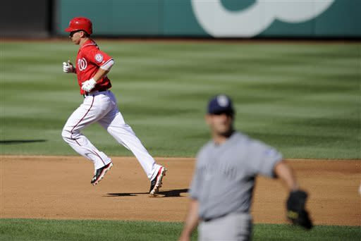 Washington Nationals' Adam LaRoche, left, rounds the bases after hitting a home run against the San Diego Padres during the fourth inning of a baseball game on Saturday, July 6, 2013, in Washington. The Nationals won 5-4. (AP Photo/Nick Wass)