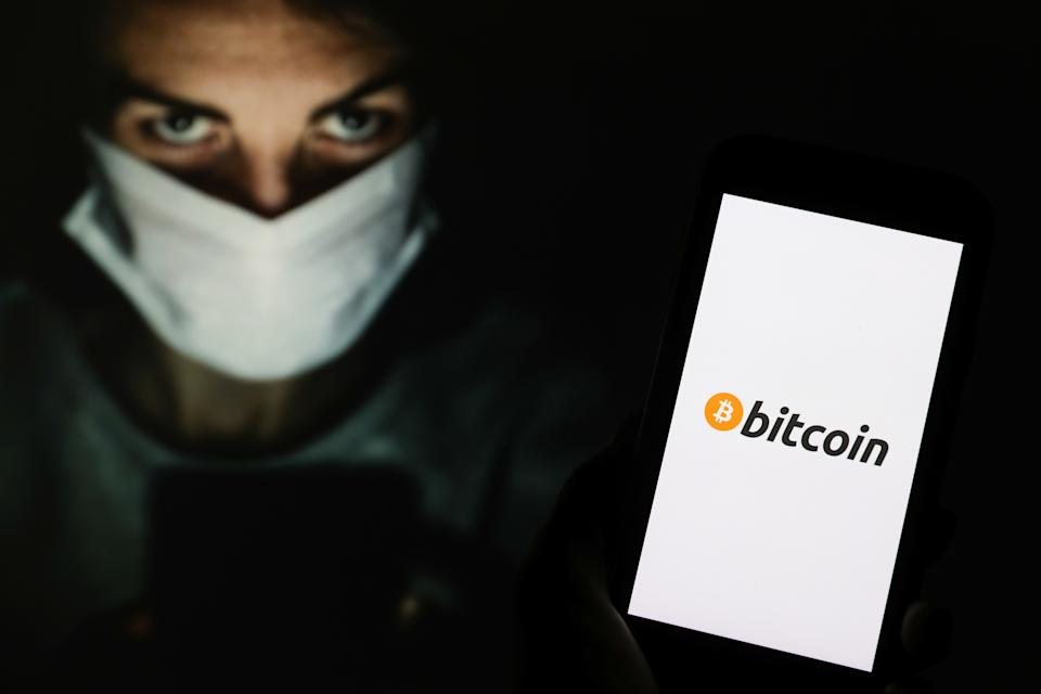 POLAND - 2020/05/04: In this photo illustration a Bitcoin cryptocurrency logo seen displayed on a smartphone. (Photo Illustration by Filip Radwanski/SOPA Images/LightRocket via Getty Images)