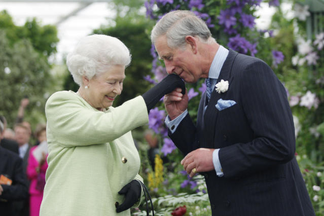 Queen Elizabeth II presents Prince Charles with the Royal Horticultural Society's Victoria Medal of Honour in 2009. (Getty Images)