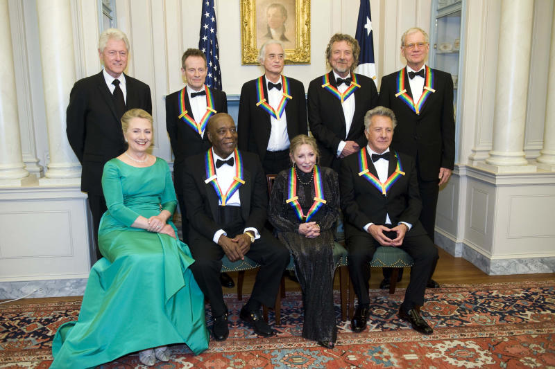From left, former President Bill Clinton, Secretary of State Hillary Rodham Clinton join the 2012 Kennedy Center Honorees John Paul Jones, Buddy Guy, Jimmy Page, Natalia Makarova, Robert Plant, Dustin Hoffman, and David Letterman for a group photo after the State Department Dinner for the Kennedy Center Honors gala Saturday, Dec. 1, 2012 at the State Department in Washington. (AP Photo/Kevin Wolf)