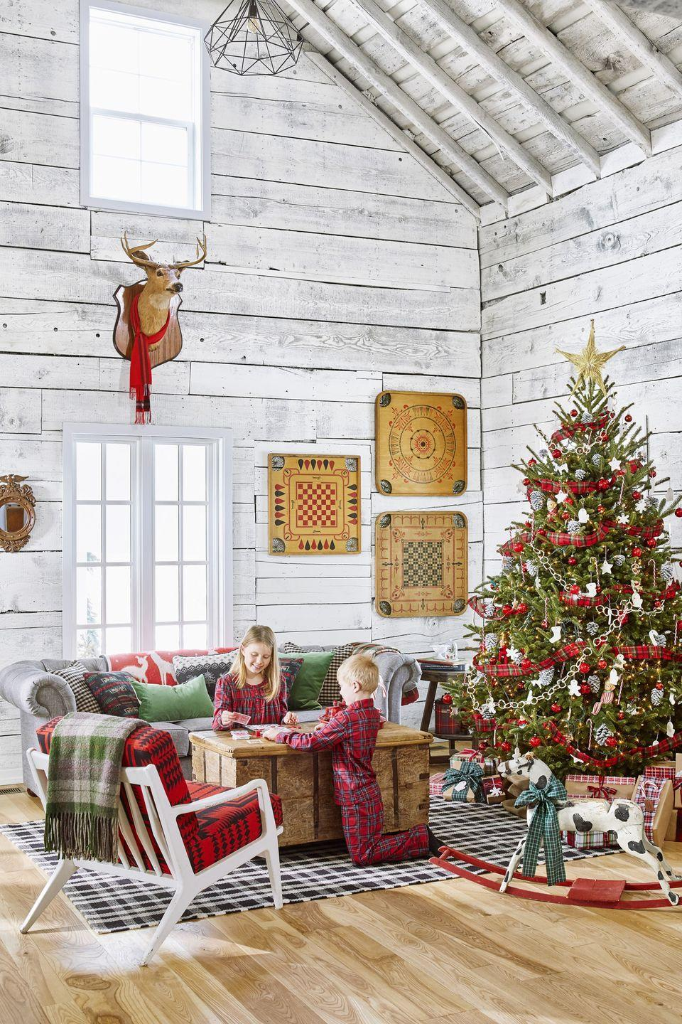 """<p>Red plaid items, which are available all year round, are conveniently completely Christmas-appropriate. This room features the <a href=""""https://www.countryliving.com/diy-crafts/g658/christmas-garlands-1208/"""" rel=""""nofollow noopener"""" target=""""_blank"""" data-ylk=""""slk:pattern in the garland"""" class=""""link rapid-noclick-resp"""">pattern in the garland</a>, <a href=""""https://www.countryliving.com/diy-crafts/tips/g645/crafty-christmas-presents-ideas/"""" rel=""""nofollow noopener"""" target=""""_blank"""" data-ylk=""""slk:on the presents"""" class=""""link rapid-noclick-resp"""">on the presents</a>, and even on the <a href=""""https://www.countryliving.com/life/kids-pets/g5033/kids-christmas-pajamas/"""" rel=""""nofollow noopener"""" target=""""_blank"""" data-ylk=""""slk:kids' pajamas"""" class=""""link rapid-noclick-resp"""">kids' pajamas</a>! </p><p><a class=""""link rapid-noclick-resp"""" href=""""https://www.amazon.com/PajamaGram-Family-Christmas-Pajamas-Set/dp/B0062YYKCW?tag=syn-yahoo-20&ascsubtag=%5Bartid%7C10050.g.1247%5Bsrc%7Cyahoo-us"""" rel=""""nofollow noopener"""" target=""""_blank"""" data-ylk=""""slk:SHOP PLAID PAJAMAS"""">SHOP PLAID PAJAMAS</a></p>"""