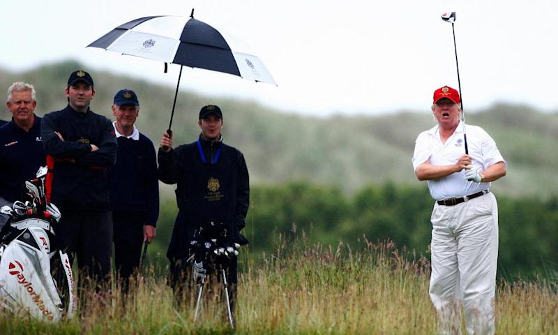 Donald Trump plays golf during the opening of his golf resort near Aberdeen.
