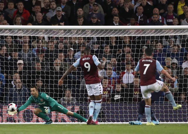 West Ham's goalkeeper Lukasz Fabianski, left, makes a save in front of Aston Villa's John McGinn, right, during their English Premier League soccer match between Aston Villa and West Ham United at Villa Park in Birmingham, England, Monday, Sept. 16, 2019. (AP Photo/Rui Vieira)