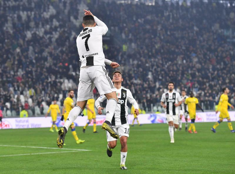 Juventus' Cristiano Ronaldo, left, celebrates with his teammate Paulo Dybala after scoring during the Serie A soccer match between Juventus and Frosinone at the Allianz Stadium in Turin, Italy, Friday, Feb. 15, 2019. (Alessandro Di Marco/ANSA via AP)