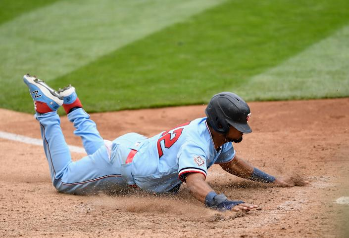 Luis Arraez scores the winning run as the Twins beat the Red Sox. (Getty Images)