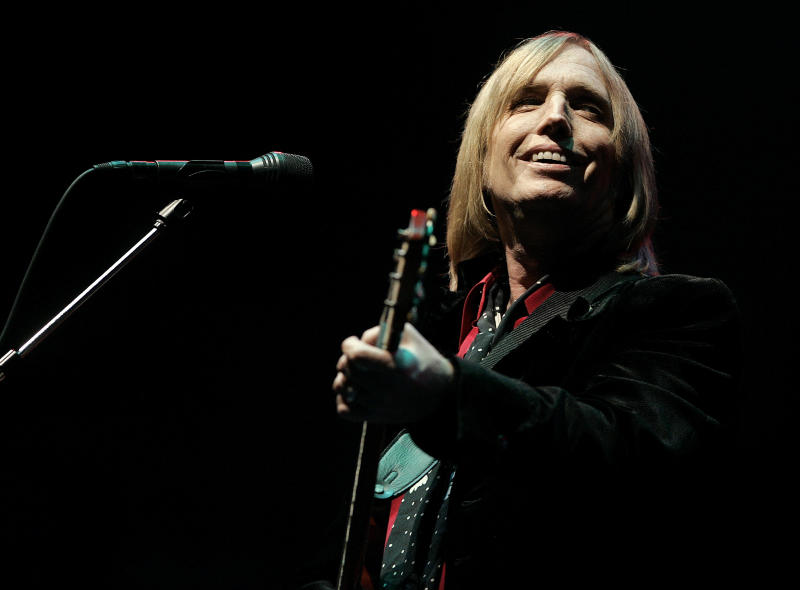 FILE - In this June 16, 2006 file photo, Tom Petty performs at the Bonnaroo Music & Arts Festival in Manchester, Tenn. Petty has died at age 66. Spokeswoman Carla Sacks says Petty died Monday night, Oct. 2, 2017, at UCLA Medical Center in Los Angeles after he suffered cardiac arrest. (AP Photo/Mark Humphrey, File)