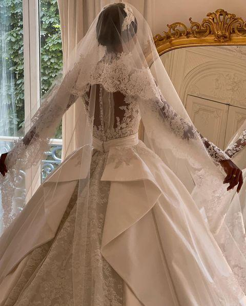 """<p>The model has officially taken the crown for the best royal-inspired wedding dress of 2021. There, we said it.</p><p>For her wedding to Snapchat's Juan David Borrero the star wore a high neck sleeved lace dress, with a detachable skirt and Cathedral-length veil, designed by Zuhair Murad. The dress looked almost identical to the gown worn by the late Grace Kelly for her marriage to Prince Rainier III of Monaco, but even grander.</p><p>'Thank you for making my classic, timeless & beautiful wedding dress come true. It is a piece of art!! Any of you figure out who my inspiration was? I want to display it like this forever in my house!' Tookes thanked Murad in her wedding post caption.</p><p>In another post, Tookes can be seen walking down the aisle in a chapel, surrounded by her loved ones, embracing her partner, and leaving the venue, which had a doorway covered in an arch of flowers similar to Meghan Markle and Prince Harry's wedding at St George's Chapel, Windsor. </p><p><a href=""""https://www.instagram.com/p/CTkt3RCBwwr/"""" rel=""""nofollow noopener"""" target=""""_blank"""" data-ylk=""""slk:See the original post on Instagram"""" class=""""link rapid-noclick-resp"""">See the original post on Instagram</a></p>"""