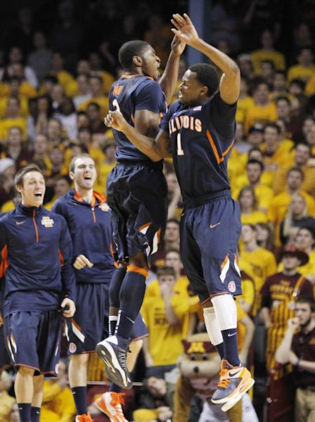 Illinois' D.J. Richardson (1) celebrates with Brandon Paul (3) after Richardson hit a 3-pointer against Minnesota during the first half of an NCAA college basketball game, Sunday, Feb. 10, 2013, in Minneapolis. (AP Photo/Genevieve Ross)
