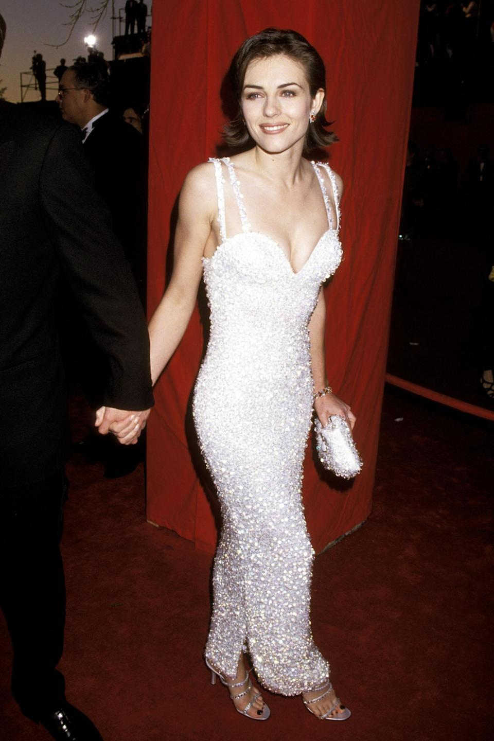 """<strong><h2>Elizabeth Hurley, 1995</h2></strong><br>Head-to-toe white? Sweetheart neckline? Floor-length sequins? Check! Check! Check!<br><br><em>Elizabeth Hurley in Versace.</em><span class=""""copyright"""">Photo: Jim Smeal/WireImage/Getty Images. </span>"""