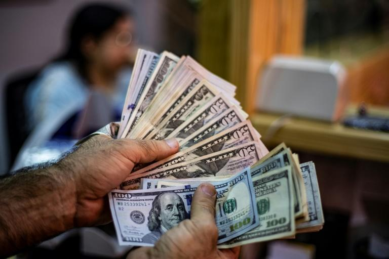 The New York Fed -- which handles the levers that control the flow of money in the system -- has for the past four days had to pump billions into money markets after bank demand for cash pushed interest rates above the Fed's target (AFP Photo/Delil SOULEIMAN)