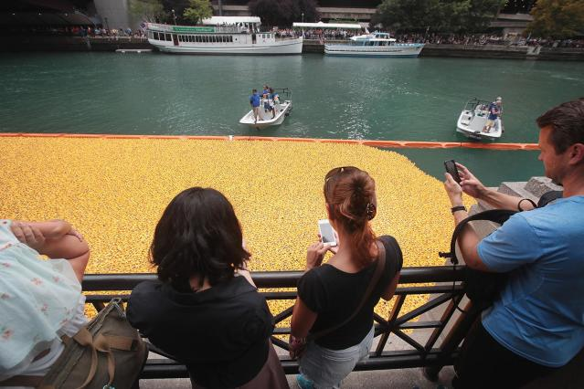 <p>Spectators watch as Rubber ducks float down the Chicago River during the Windy City Rubber Ducky Derby on August 3, 2017 in Chicago, Illinois. (Photo: Scott Olson/Getty Images) </p>