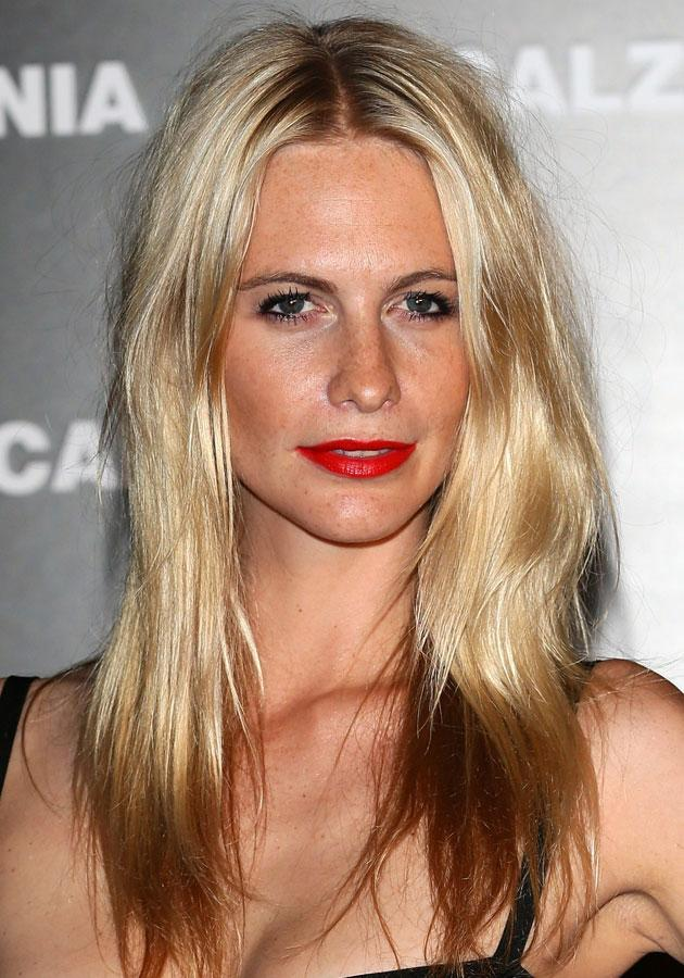 """Celebrities wearing red lipstick: <a href=""""http://uk.lifestyle.yahoo.com/poppy-delevingne-calzedonia-summer-show-forever-together-rimini-italy-fashion-style-looks-pictures-091640237.html"""" data-ylk=""""slk:Poppy Delevingne;outcm:mb_qualified_link;_E:mb_qualified_link;ct:story;"""" class=""""link rapid-noclick-resp yahoo-link"""">Poppy Delevingne</a> wore her bright red pout with dip-dyed ends.<br><br>[Getty]"""