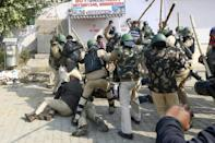 Supporters and opponents of Indian farmers protesting rural reforms clashed, with police charging both groups to keep them apart