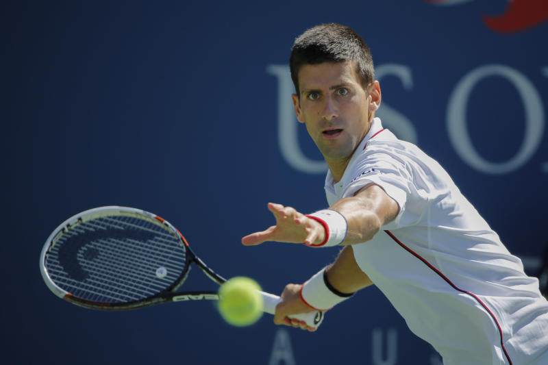 Novak Djokovic of Serbia returns a shot to Paul-Henri Mathieu of France during their 2014 US Open men's singles match on August 28, 2014 in New York