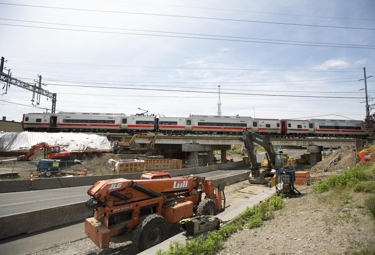 FAIRFIELD, CT - MAY 18: The scene of a Metro North train collision on May 18, 2013 in Fairfield, Connecticut.  Two New Haven Line Metro North commuter trains collided on Friday, May 17 near Bridgeport, CT, injuring as many as 70 people.  (Photo by Michael Graae/Getty Images)