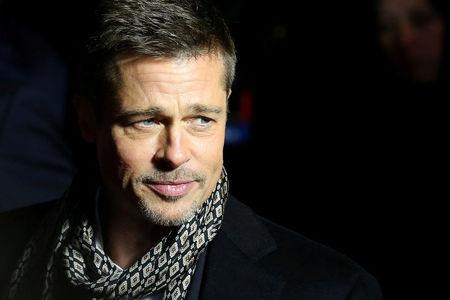 """FILE PHOTO: Actor Brad Pitt arrives at the premiere of the film """"Allied"""" in Madrid, Spain on November 22, 2016. REUTERS/Juan Medina/File Photo"""