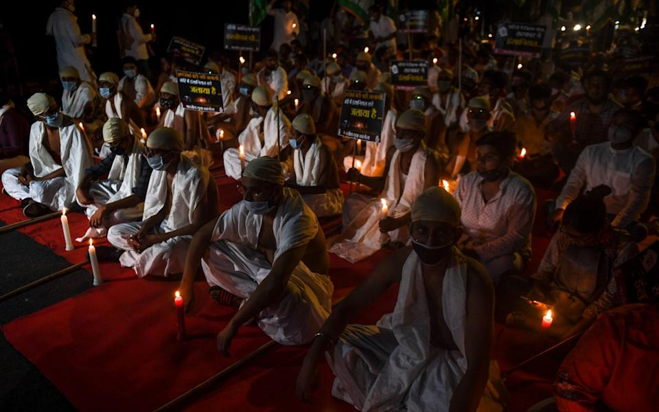 Activists of the Indian Youth Congress during a candlelit vigil to demand justice for Manisha Valmiki - Money Sharma/AFP