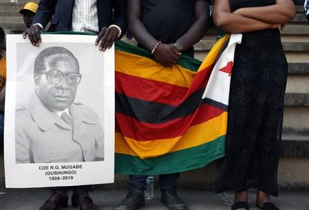 Zimbabwe's Mugabe died from cancer, president says