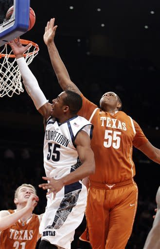Georgetown's Jabril Trawick (55) drives past Texas' Cameron Ridley, right, during the first half of their NCAA college basketball game in the Jimmy V Classic, Tuesday, Dec. 4, 2012, at Madison Square Garden in New York. (AP Photo/Frank Franklin II)