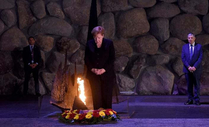 German Chancellor Angela Merkel pauses after laying a wreath in the Hall of Remembrance in the Yad Vashem Holocaust Museum in Jerusalem, on October 4, 2018 (AFP Photo/DEBBIE HILL)