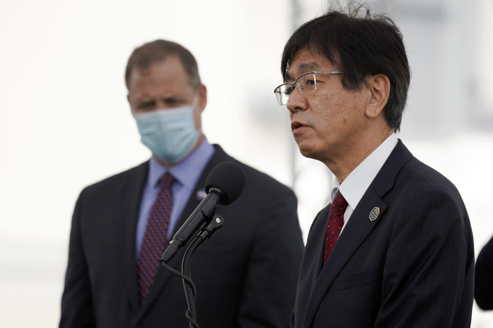 Hiroshi Sasaki, right, vice president and director general, Japanese Space Agency Human Spaceflight Technology Directorate speaks as NASA administrator Jim Bridenstine, left, listens during a news conference at the Kennedy Space Center in Cape Canaveral, Fla., Friday, Nov. 13, 2020. (AP Photo/John Raoux)